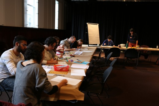 All are working hard on their drawings so that Lisa Ullén can play them. Photo credit: Roisin Adams