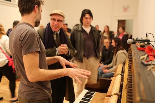 Andrew Wedman talks with Hank Bull. Photo by Roisin Adams
