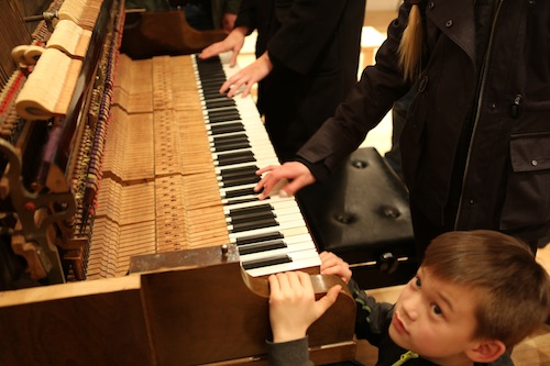 Guests get their hands on the Bass Piano. Photo by Roisin Adams