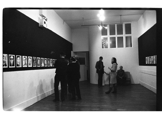 """Guests chat in groups at Israel Charney's drawing exhibition: """"Orgy on the Bounty"""", 1982"""