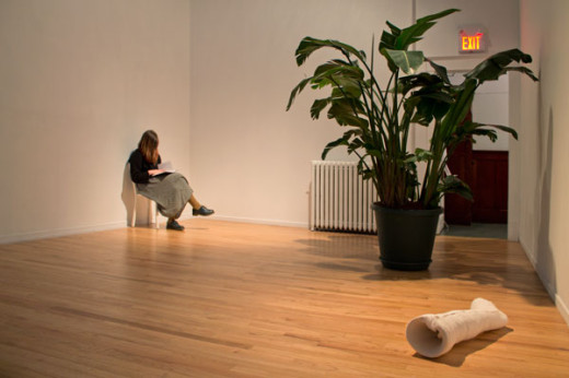 "Abbas Akhanvan, Installation view of green house, 2013 (from left: Cast, gallery sitters reading from ""The Natural History of a Garden""; Consort, bird of paradise plant; Tame, plaster, fabric)"