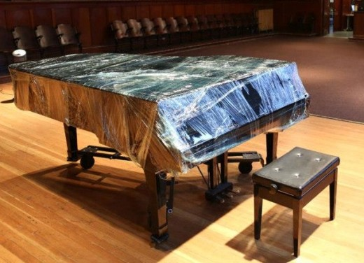 Western Front's Disklavier piano, wrapped and ready for restoration.