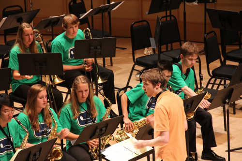 Adam Gough conducts a youth jazz band.