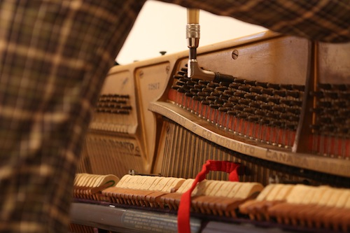 Andrew Wedman tuning his piano. Photo by Ekaterina Usmanova