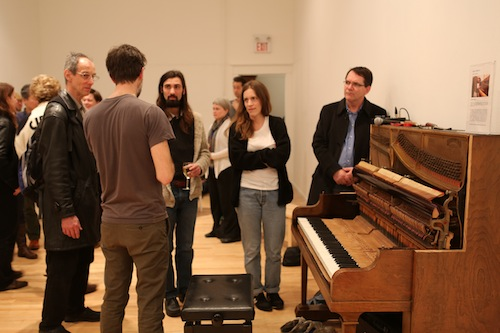 Andrew Wedman talks to guests. Photo by Roisin Adams