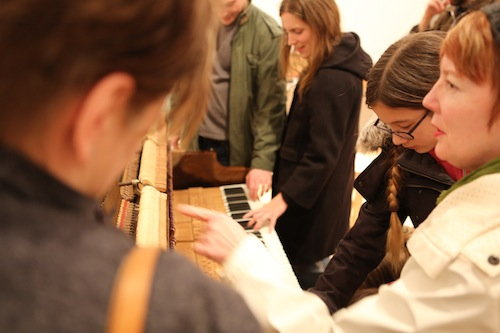 Guests exploring the Bass Piano. Photo by Roisin Adams